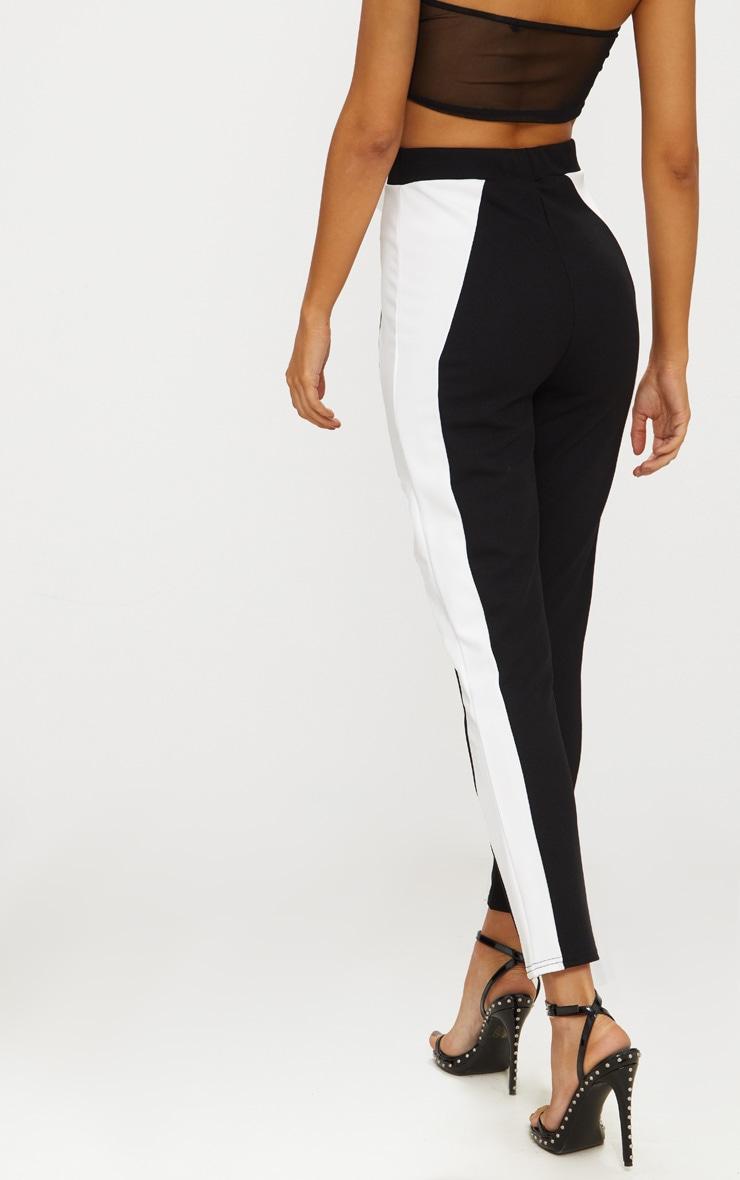 pantalon cigarette noir bande blanche sur les c t s pantalons prettylittlething fr. Black Bedroom Furniture Sets. Home Design Ideas