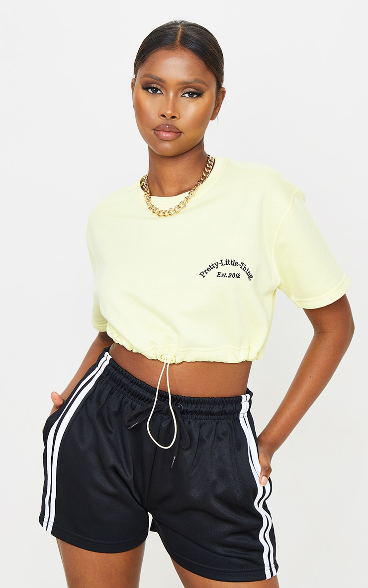 PRETTYLITTLETHING Pale Yellow Embroidered Short Sleeve Toggle Sweatshirt 1