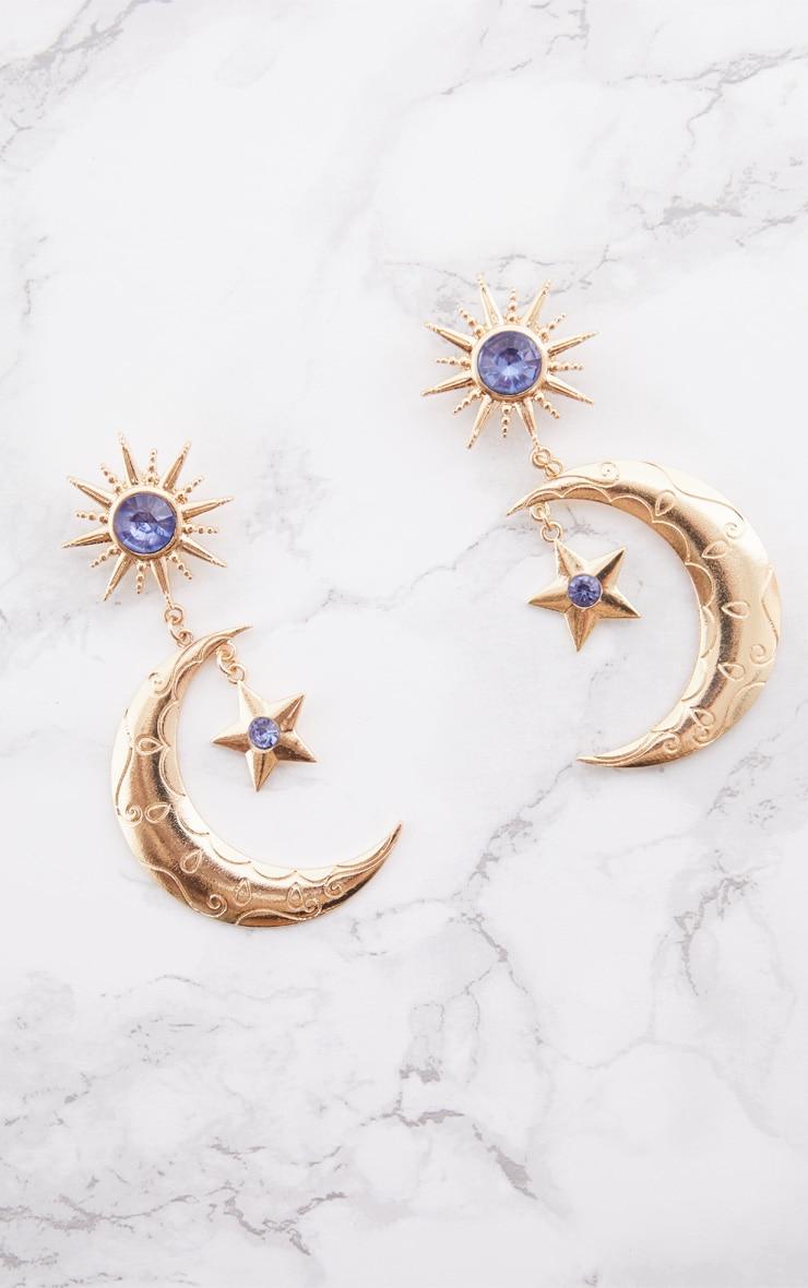 Boucles d oreilles dorées à soleil, étoile et pierres fantaisie bleues 3