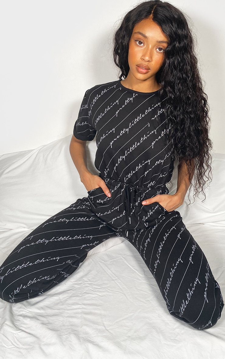 PRETTYLITTLETHING Black Short Sleeve Sweat Jumpsuit 1