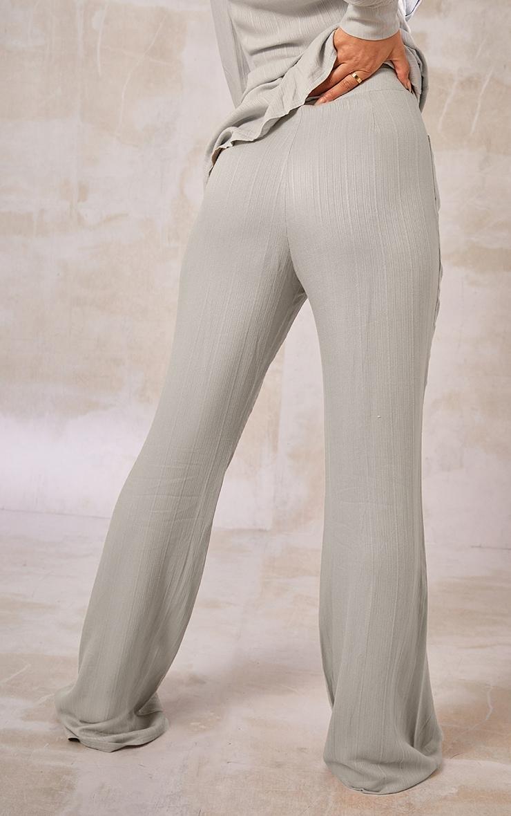 Pantalon jambes évasées vert sauge à rayures texturées et poches 3