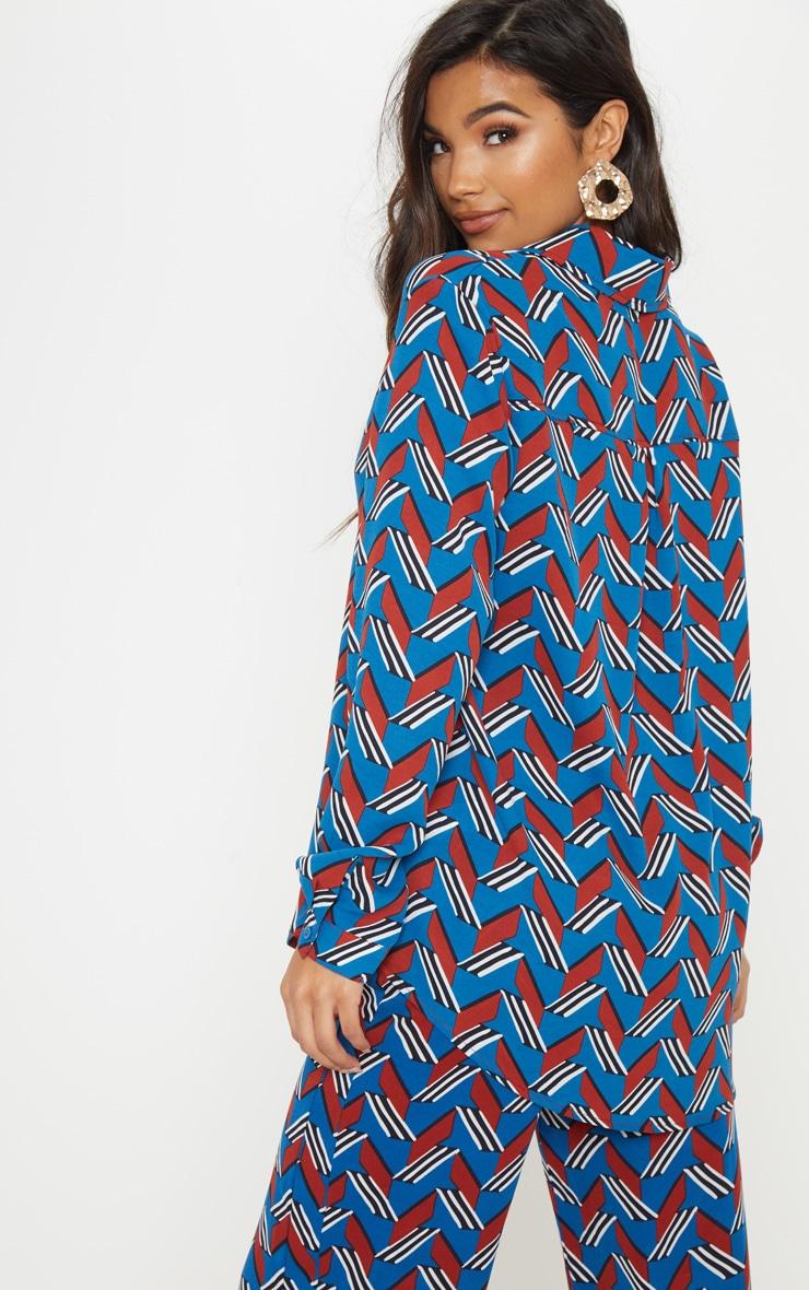 Chemise bleue oversized à colourblock chevrons colorés 2