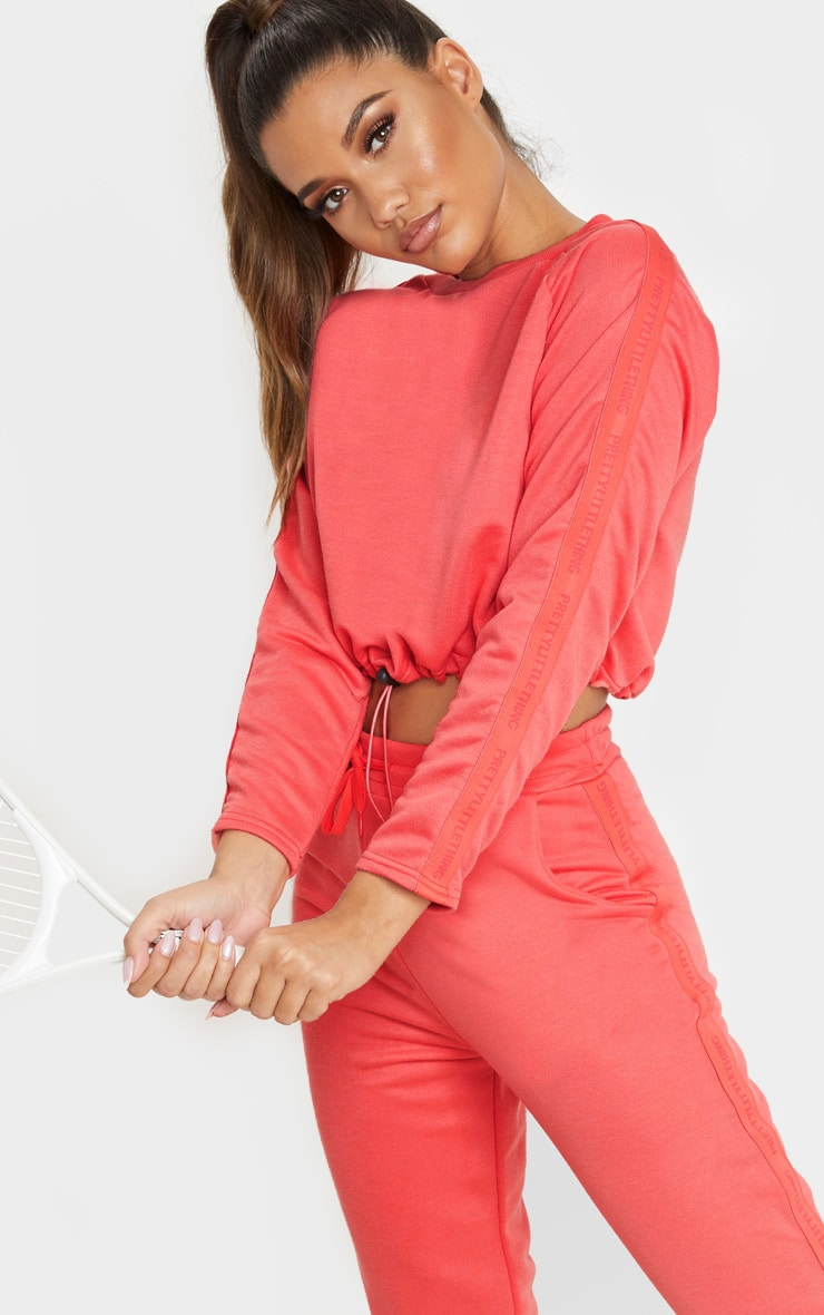 PRETTYLITTLETHING Coral Cropped Toggle Tie Sweat 1