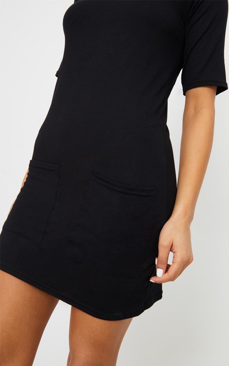 Robe t-shirt noire à détail poches 5