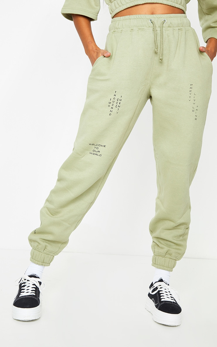 PRETTYLITTLETHING Olive Green Welcome To Our World Slogan Joggers 2