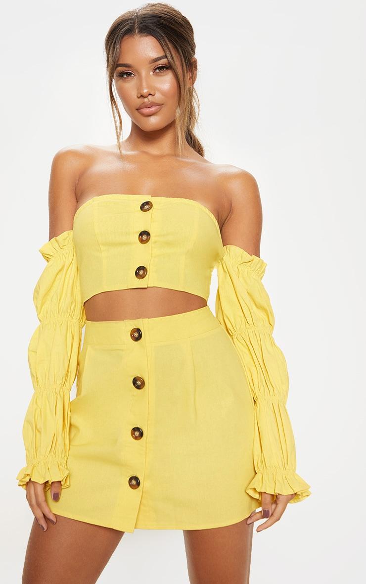 Mini-jupe jaune en coton à boutons devant 1