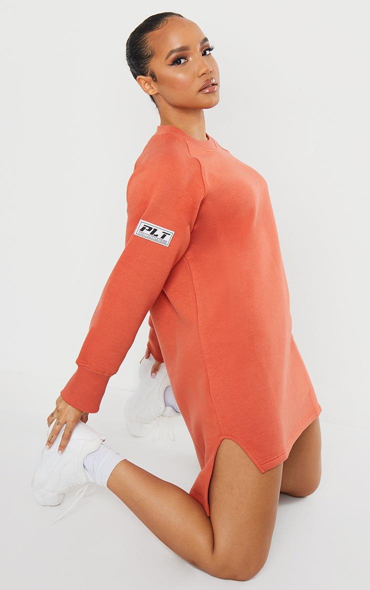 PRETTYLITTLETHING Washed Red Slogan Dip Hem Sweat Sweater Dress 3