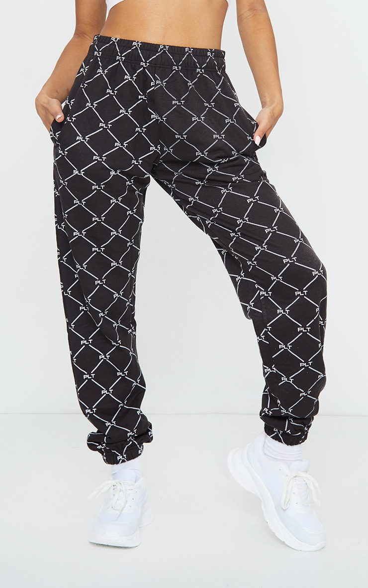 PRETTYLITTLETHING Black Repeat Print Joggers 2