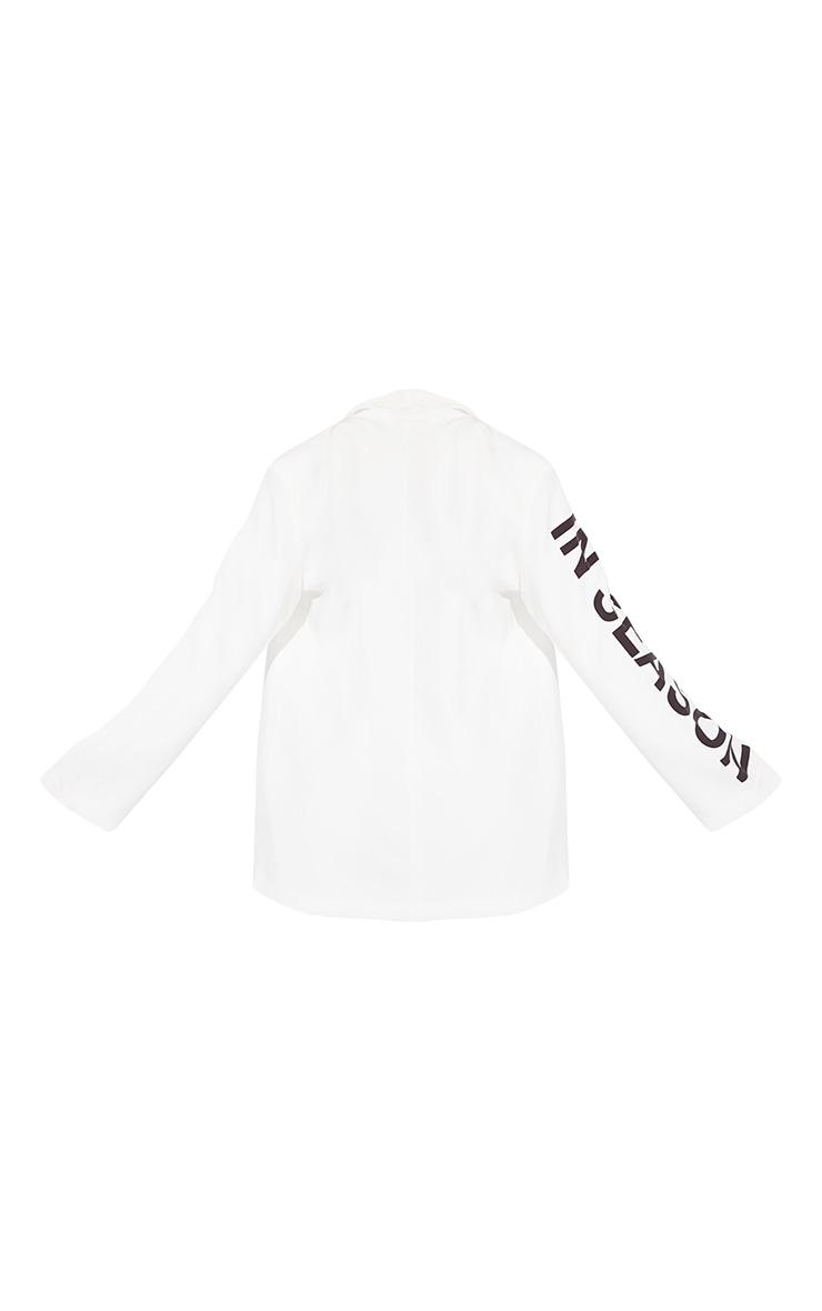 Blazer blanc à revers satiné et slogan 6