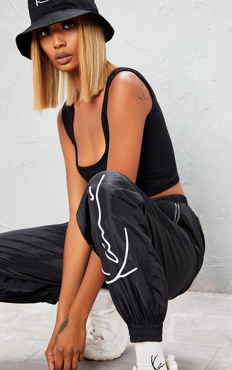 KARL KANI Black Embroidered Shell Joggers 7