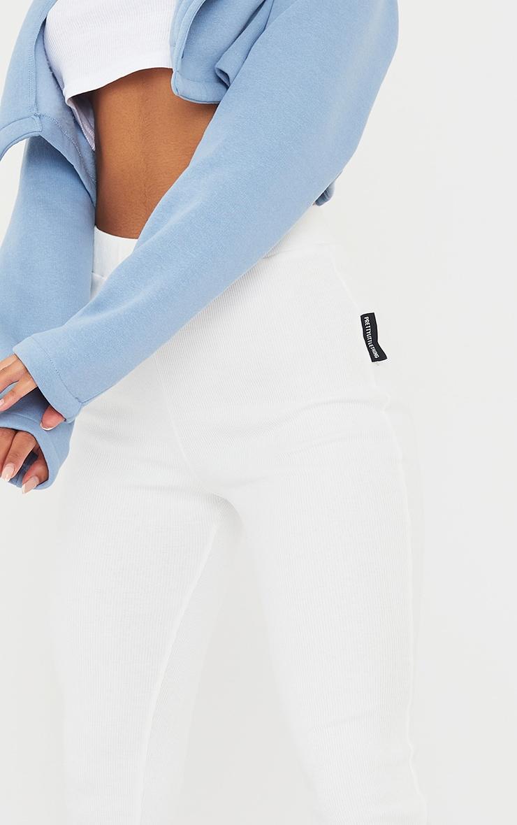 PRETTYLITTLETHING Cream Ribbed Zip Split Hem Leggings 4