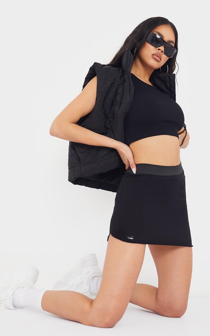 PRETTTYLITTLETHING Black Sweat Mini Skirt 1