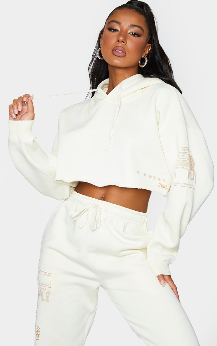PRETTYLITTLETHING Cream Branded Archive Printed Cropped Hoodie 1