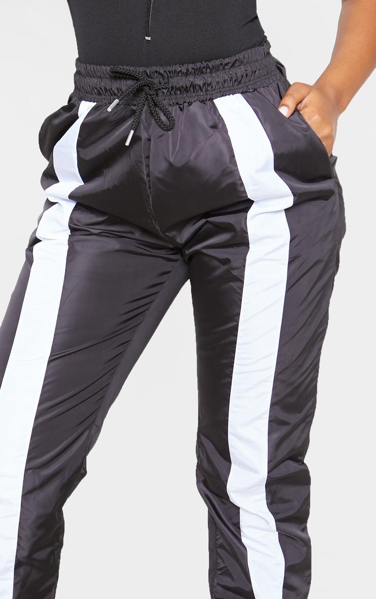 Jogging souple noir à parties blanches contrastantes 5