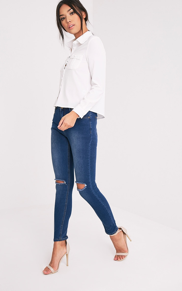 Mid Wash Knee Rip Slim Jean 1