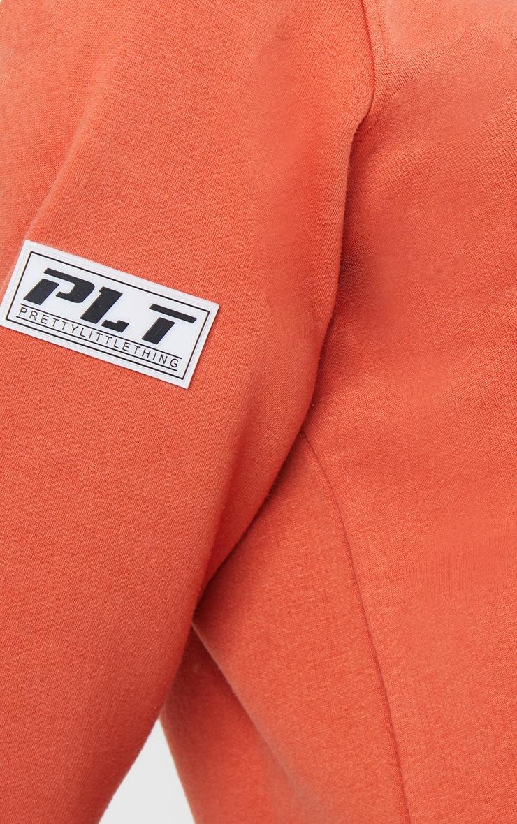 PRETTYLITTLETHING Washed Red Slogan Dip Hem Sweat Sweater Dress 4