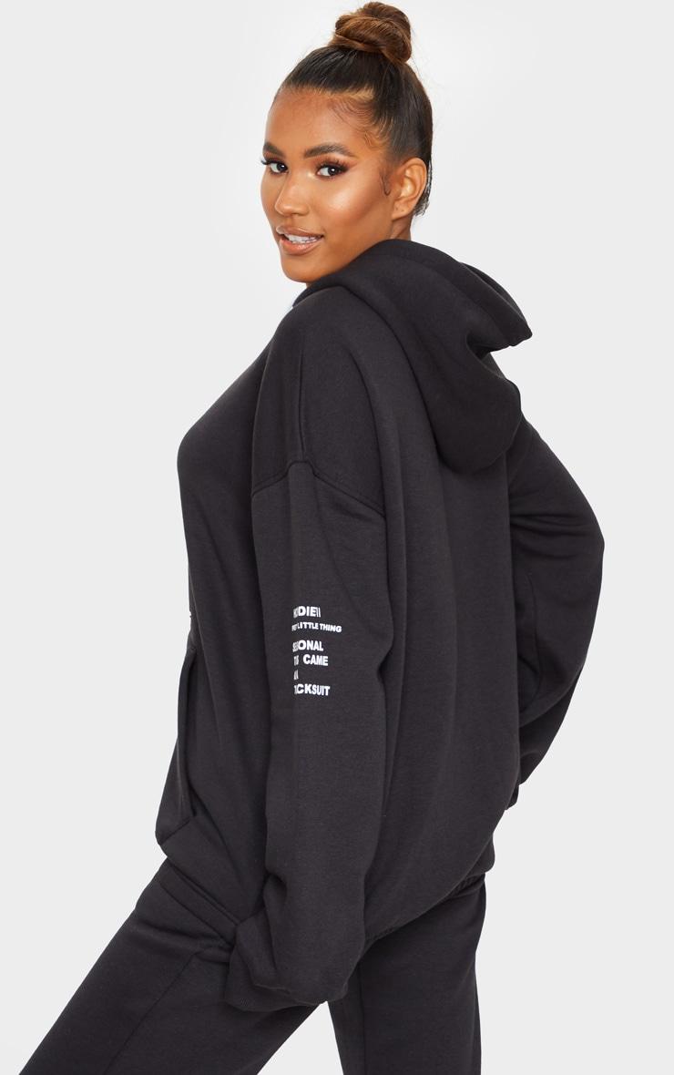 PRETTYLITTLETHING Black Oversized Slogan Print Pocket Front Hoodie 2