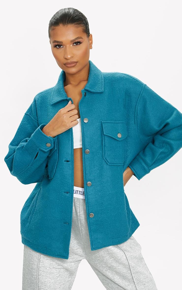 Veste style chemise bleu sarcelle à poches devant 1