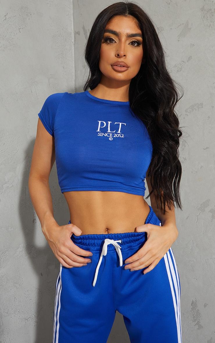 PRETTYLITTLETHING Cobalt Established Slogan Short Sleeve Crop T Shirt 1