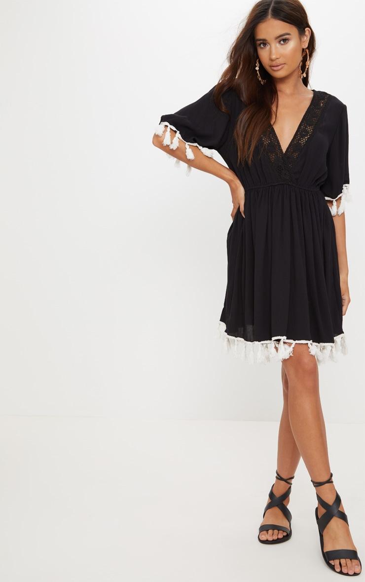 Black Tassel Trim Plunge Skater Dress by Prettylittlething