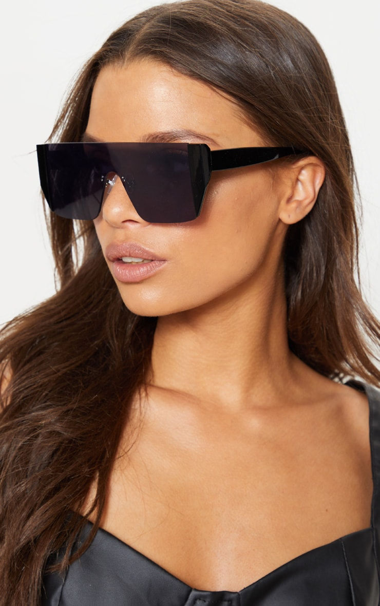 Black On Black Frameless Oversized Sunglasses            1