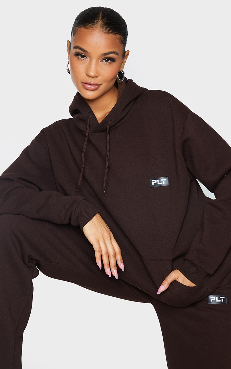 PRETTYLITTLETHING Chocolate Badge Detail Oversized Hoodie 1