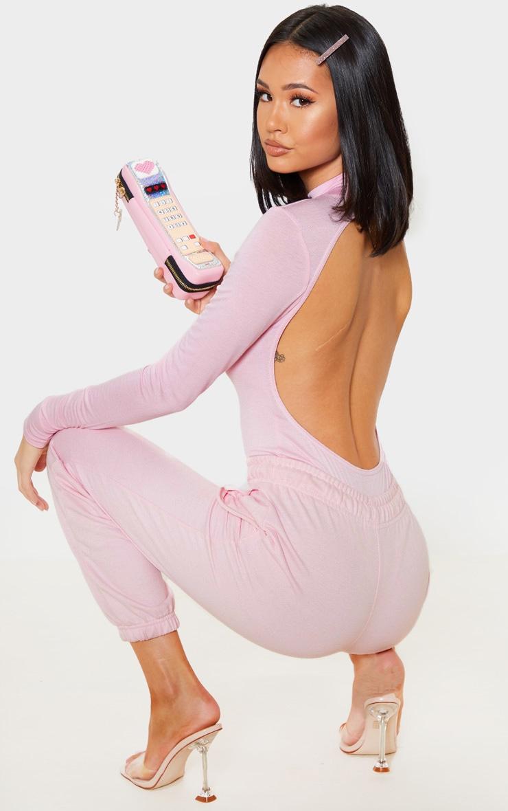Body-string en jersey rose à détail dans le dos 1