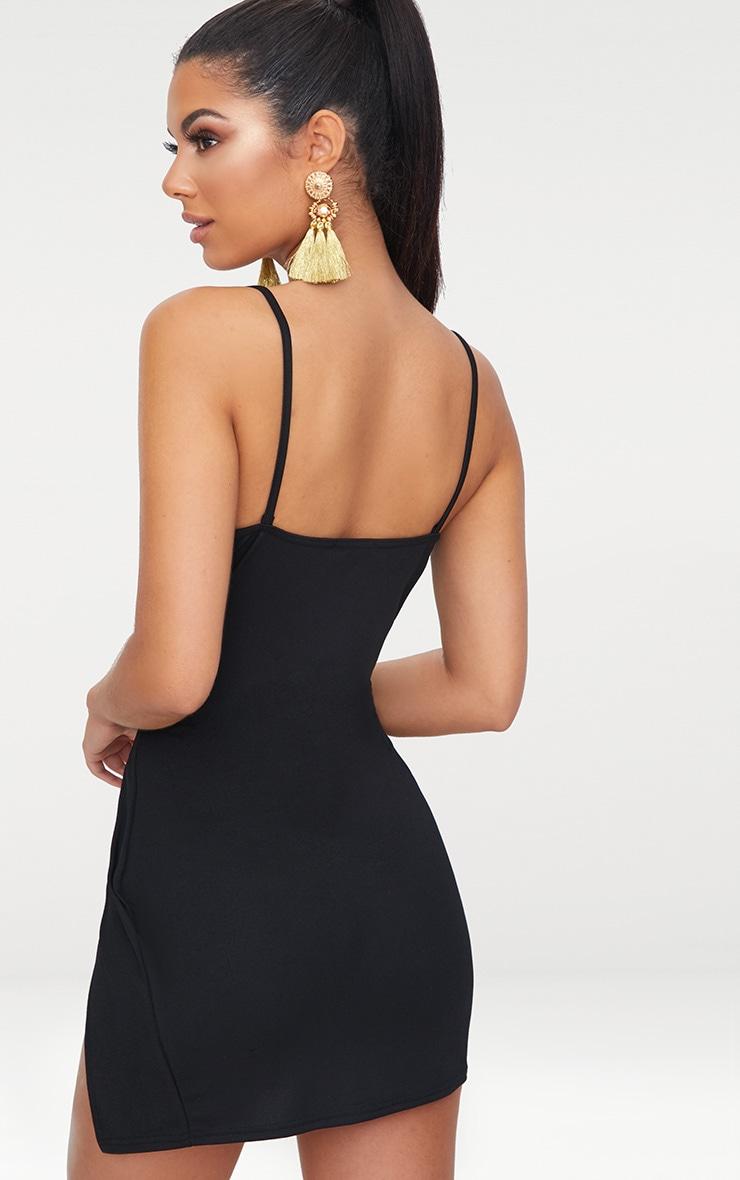 فستان أسود مجسم مخروطي الشكل بفتحة جانبية طويلة عند الفخذ وفتحة عند الصدر 2