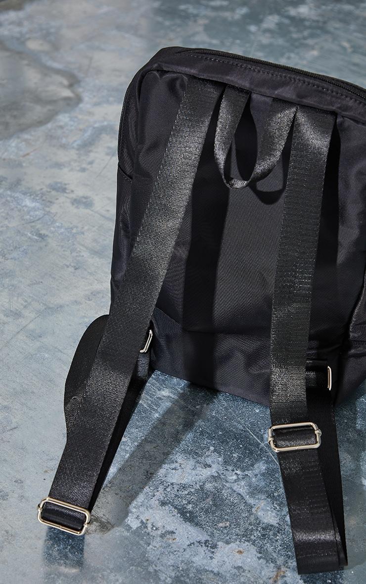 PRETTYLITTLETHING Black Round Badge Backpack 3