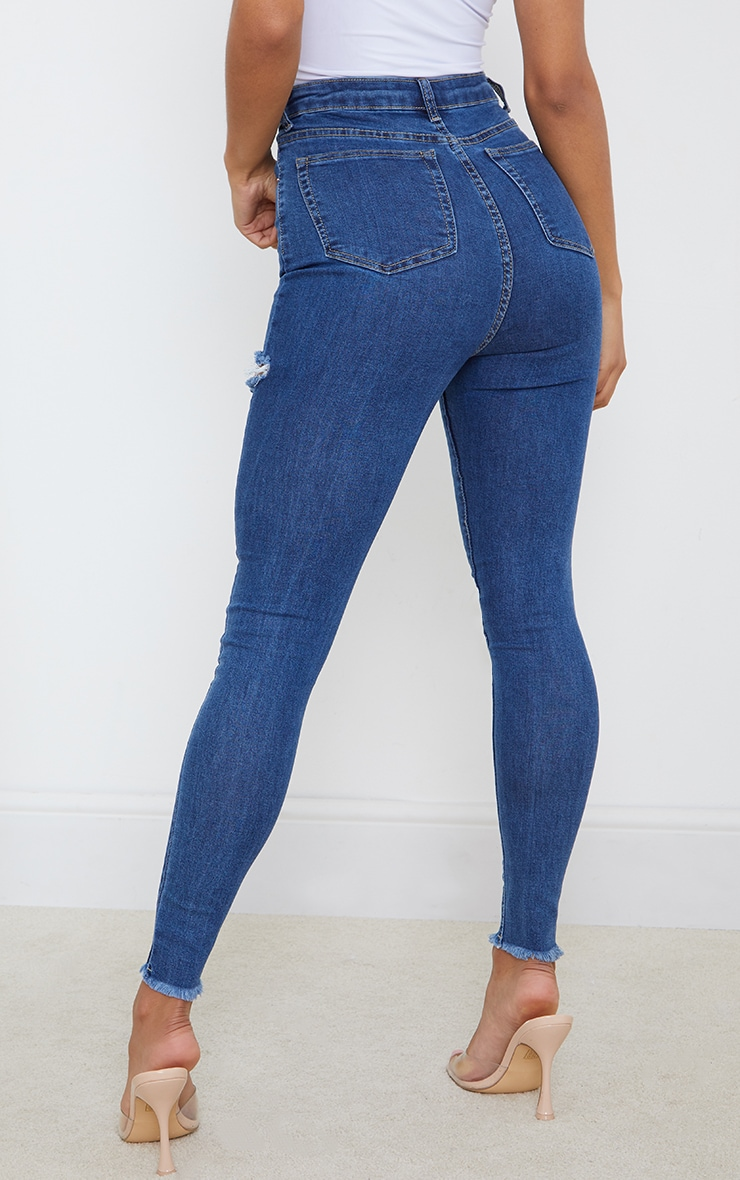 Mid Blue Wash Thigh Rip Raw Hem 5 Pocket Skinny Jean 3