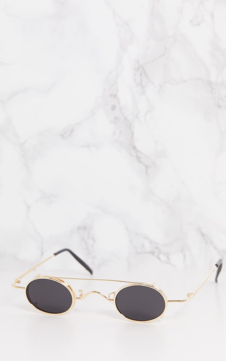 7a3bc2fc5 Gold Frame Black Lens Small Oval Flip Sunglasses | PrettyLittleThing