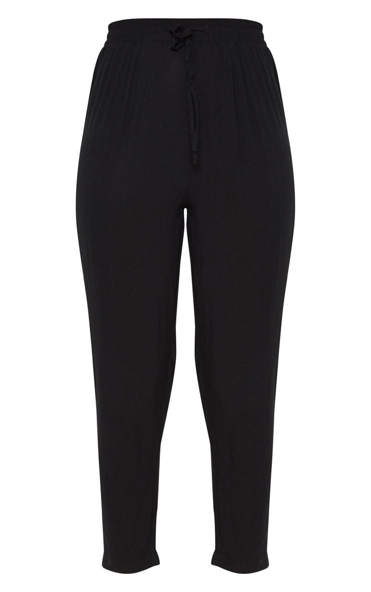 Pantalon casual noir à cordon ajustable et double bande blanche  3