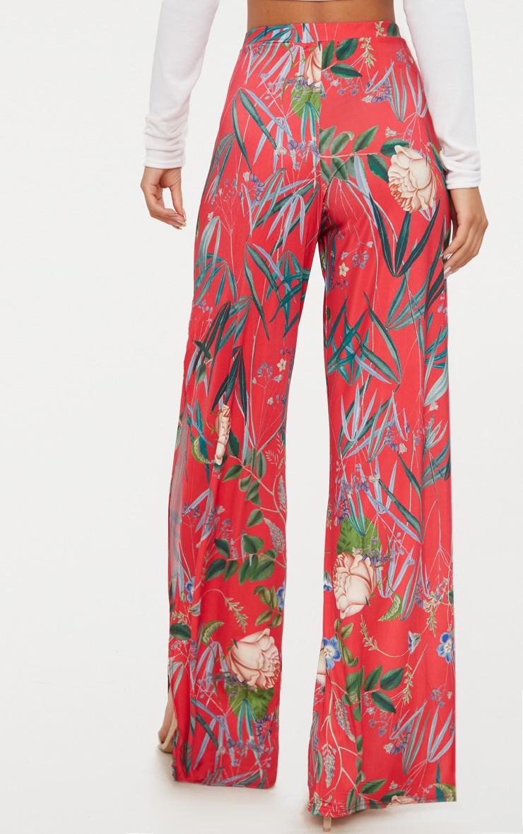 Pantalon ample rouge à imprimé floral fendu sur le côté 4