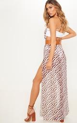 a2816b3b1e76 Brown Zebra Belted Beach Maxi Dress | PrettyLittleThing
