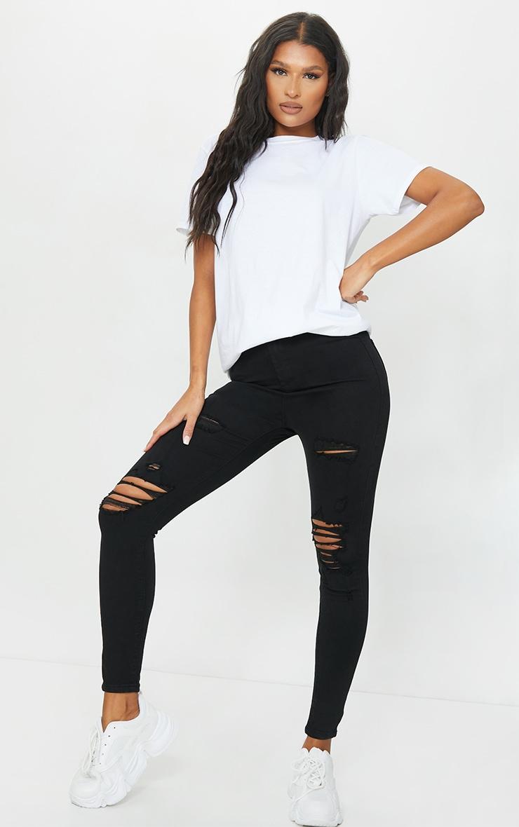 PRETTYLITTLETHING Black Distressed Disco Skinny Jean 1