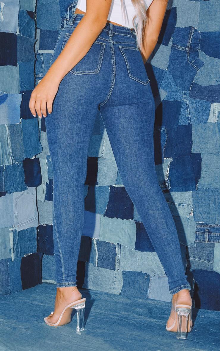 PRETTYLITTLETHING Mid Wash Distressed 5 Pocket Skinny Jean 4