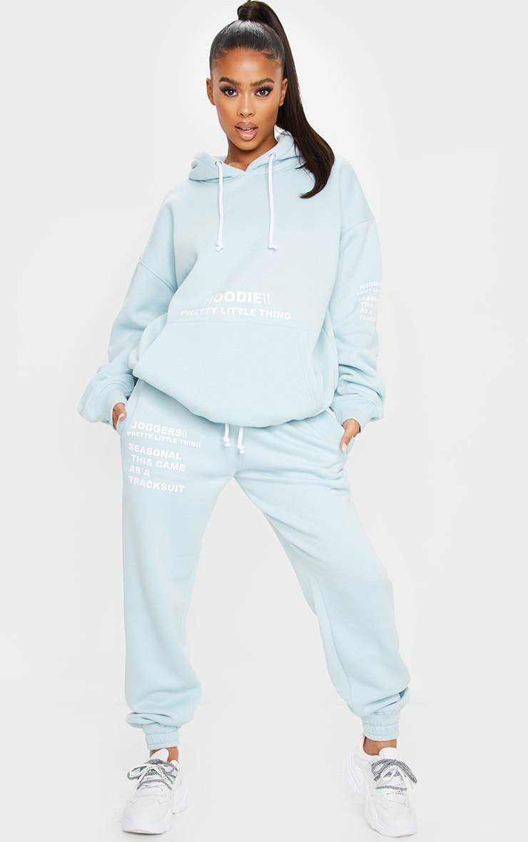 PRETTYLITTLETHING Light Blue Haze Slogan Print Jogger 1