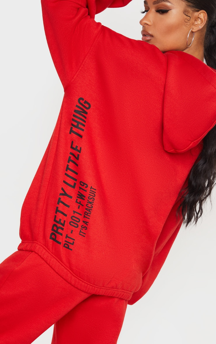 PRETTYLITTLETHING Red Oversized Slogan Back Pocket Front Hoodie 1