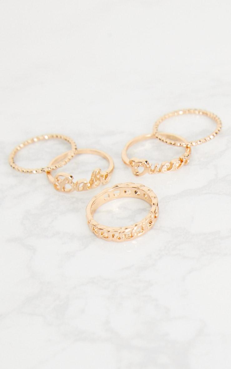 Gold Slogan Ring Pack 4