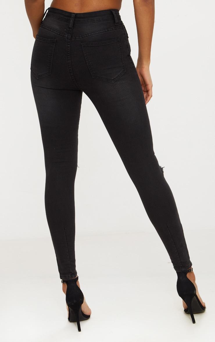 Jean skinny noir délavé ouvert au genou avec 5 poches 4