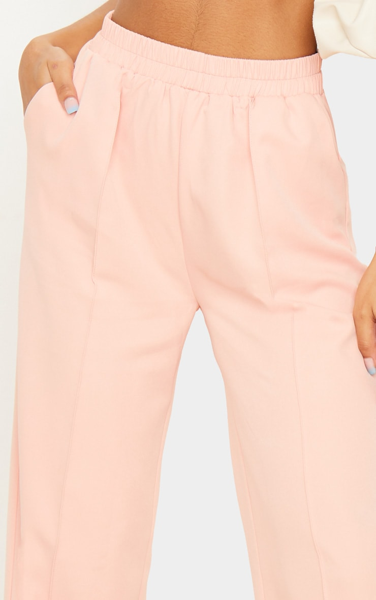 Pantalon rose jambes évasées à taille froncée 5