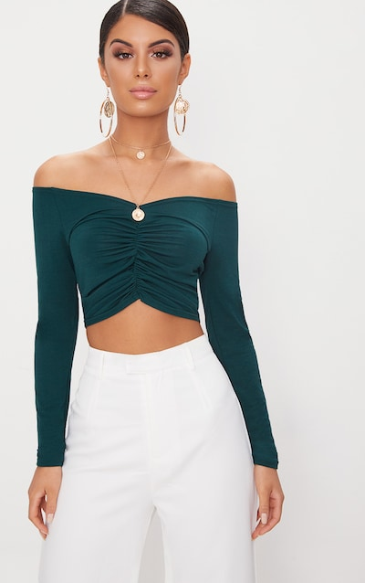 5a5fd88a1c7ee Emerald Green Slinky Ruched Front Long Sleeve Crop Top