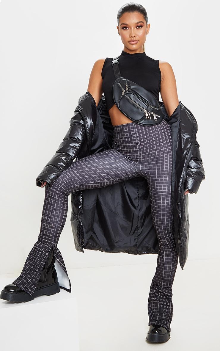 Pantalon flare noir fendu à carreaux 1
