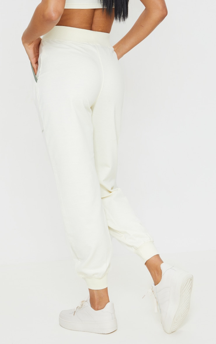 PRETTYLITTLETHING Cream Printed Contrast Piping Joggers 4