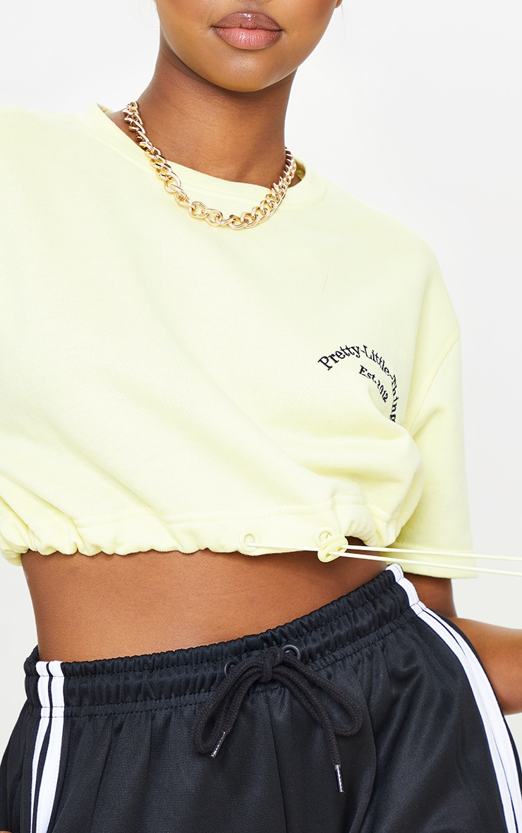 PRETTYLITTLETHING Pale Yellow Embroidered Short Sleeve Toggle Sweatshirt 4