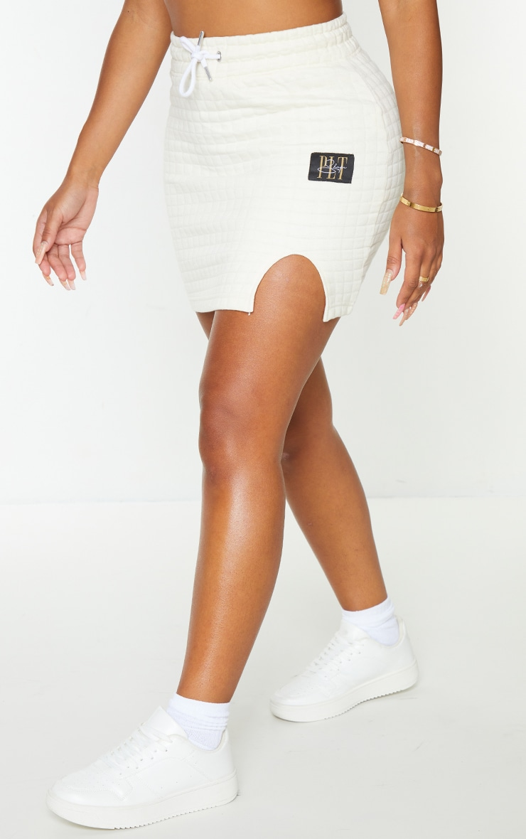 PRETTYLITTLETHING Shape Cream Quilted Drawstring Bodycon Skirt 2