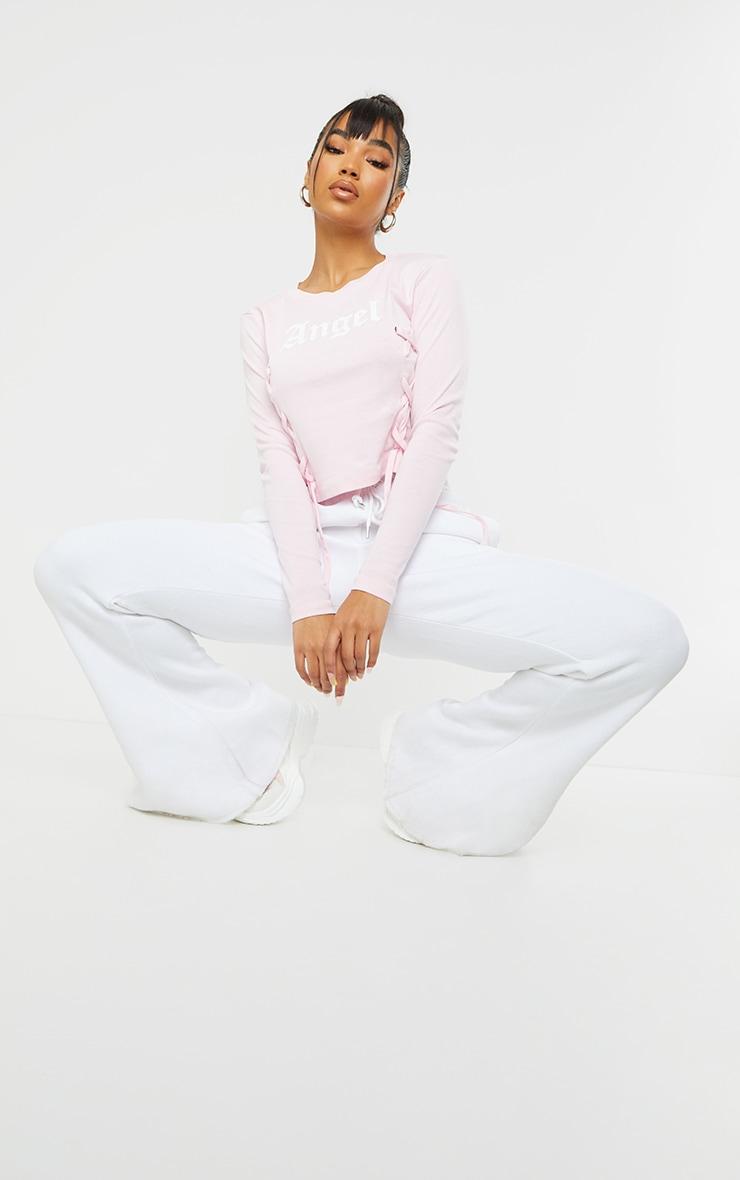 Baby Pink Angel Printed Lace Up Long Sleeve Crop Top 3