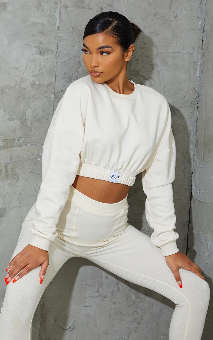 PRETTYLITTLETHING Cream Elasticated Hem Long Sleeve Crop Sweater 1