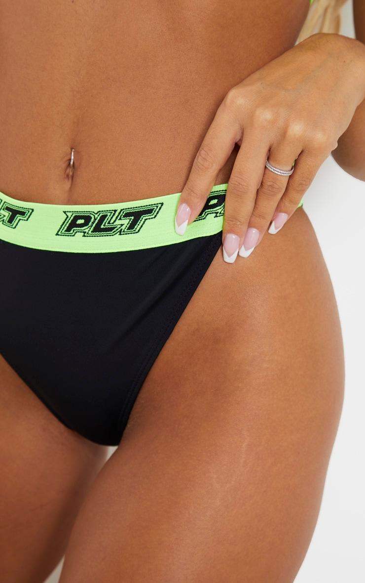 PRETTYLITTLETHING Black Racer Tape Bikini Bottom 5