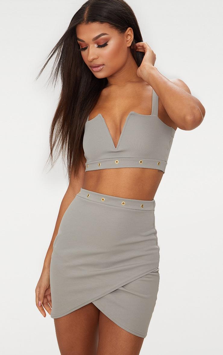 Mini-jupe drapée gris anthracite à détail oeillets